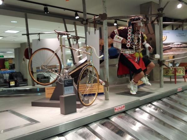 This bicycle display next to an Indigenous heritage display at the Calgary airport.